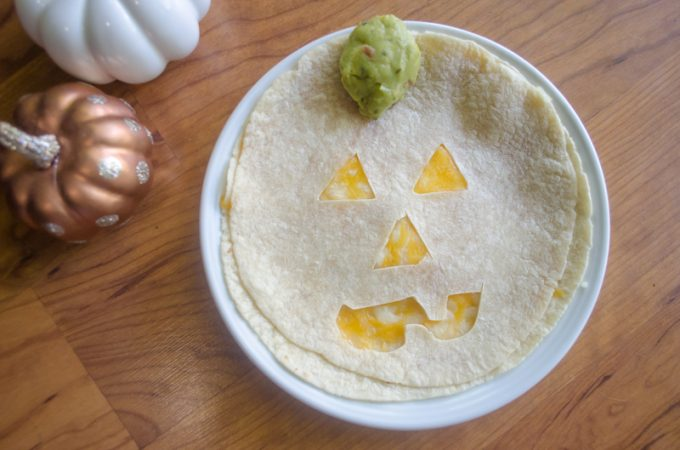 How to make a fun Halloween Jack-O-Lantern Quesadilla Quesadillas with these easy instructions. Grab a fun Halloween dinner idea.