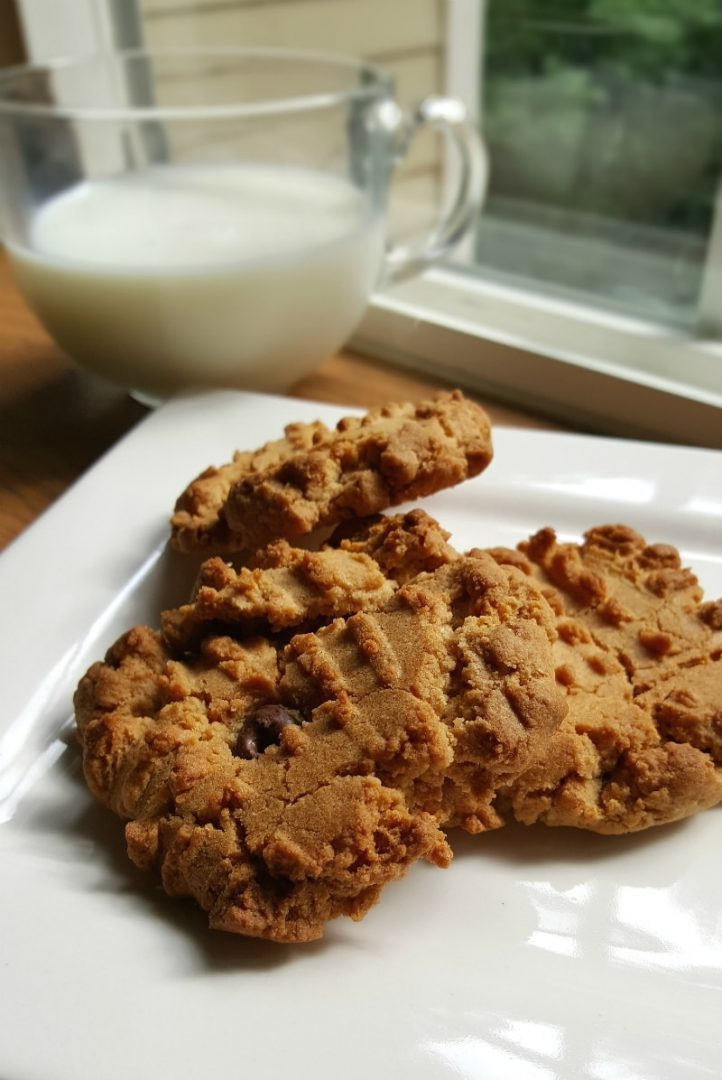 peanut butter cookies on white plate with a glass of milk