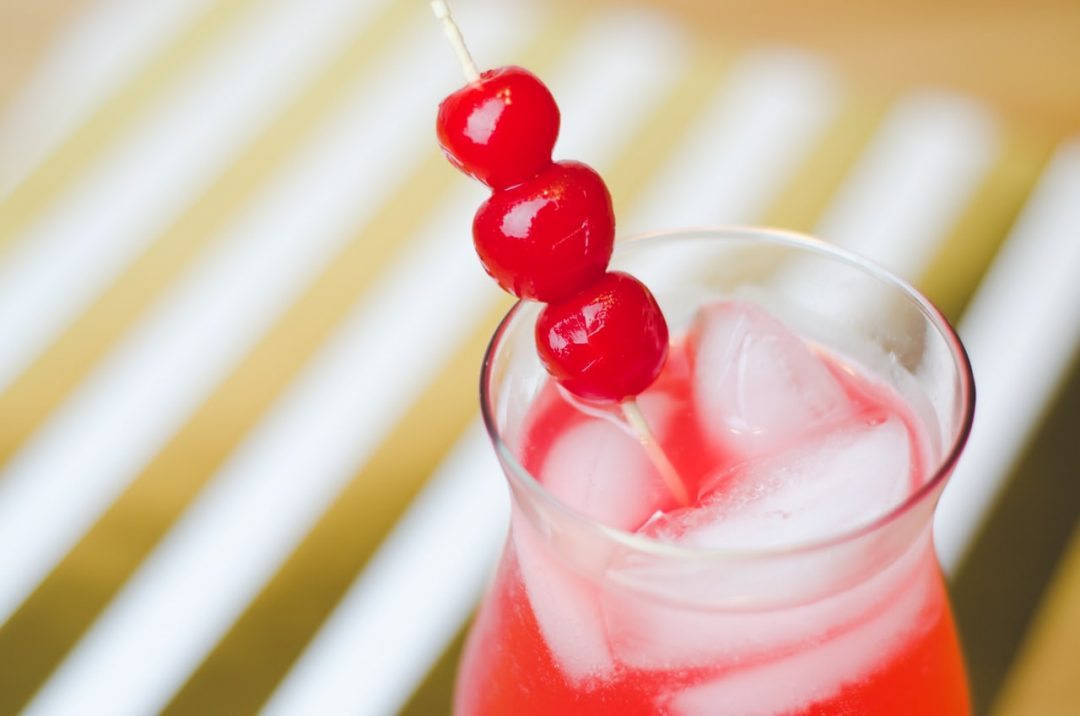 cherries on a stick in glass
