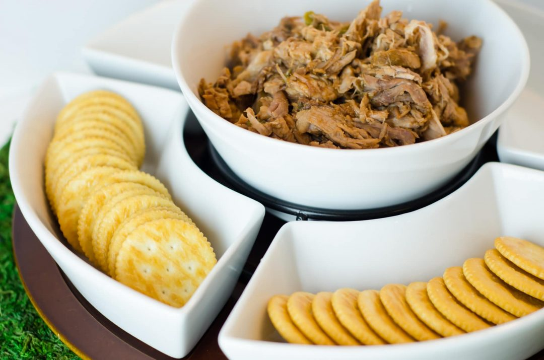 crackers and meat dip in serving tray