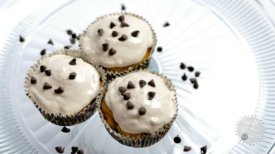 cupcakes with white frosting and chocolate chips on the top