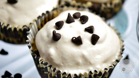 white frosted cupcakes with chocolate chips on the top