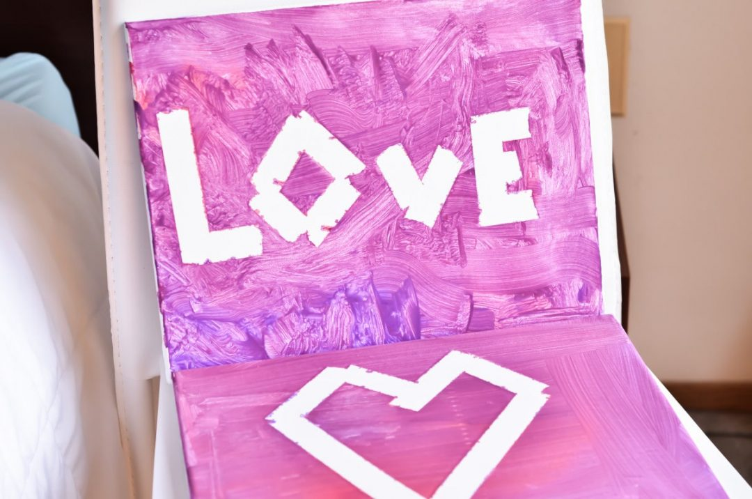 canvas art painted pink and purple with a heart and word love