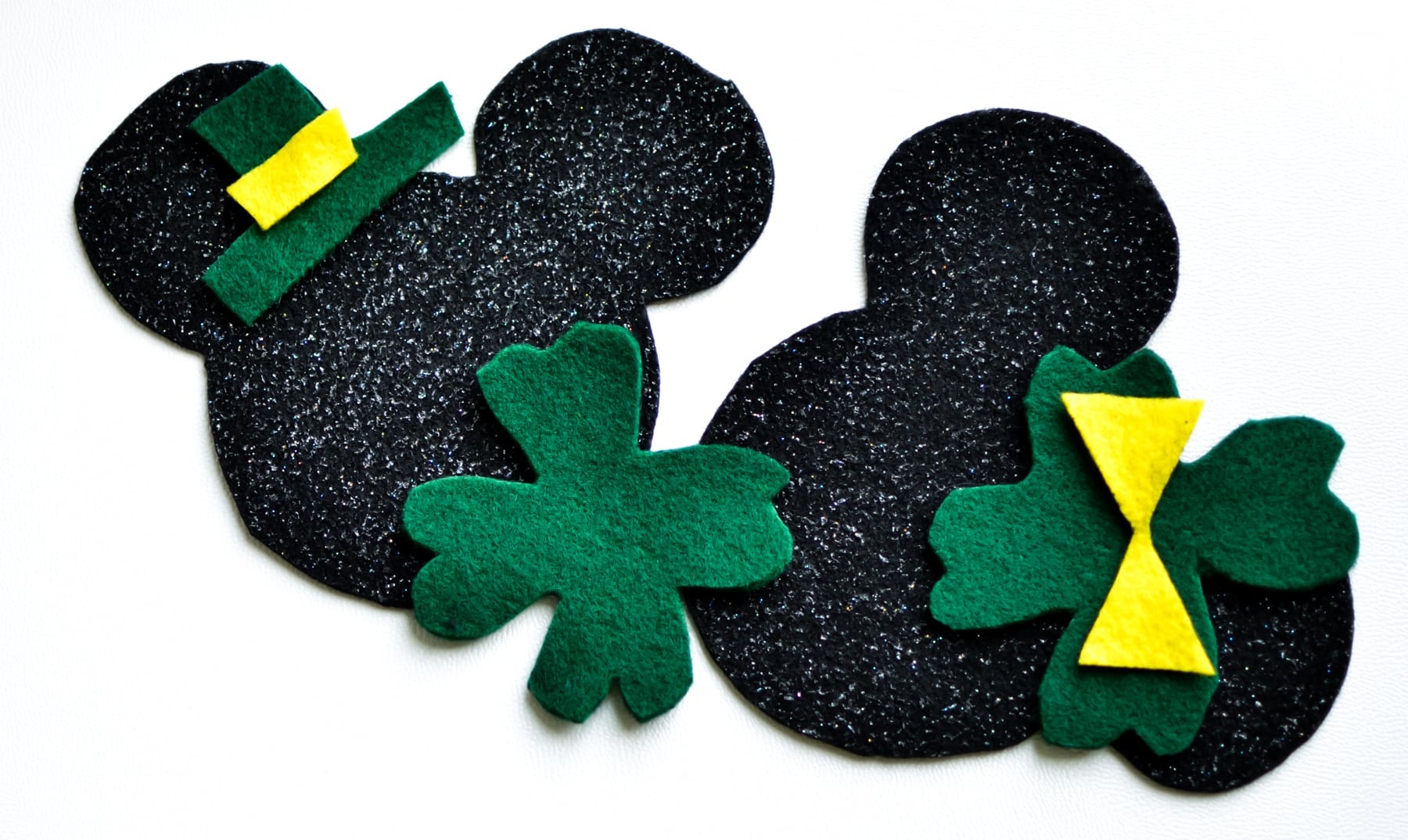 St. Patrick's Day Felt Craft - Featuring Mickey and Minnie Mouse for a fun activity for kids this holiday. A fun way to celebrate St. Patrick's Day with more magic!