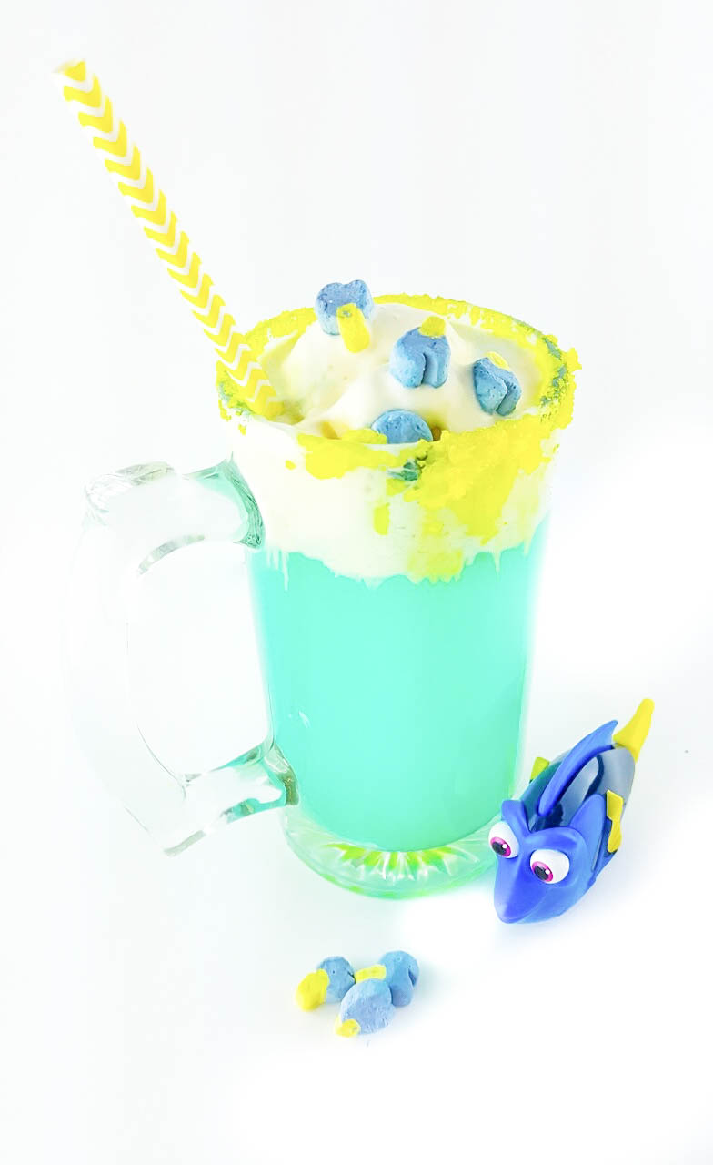 dory party punch in a clear mug with yellow straw