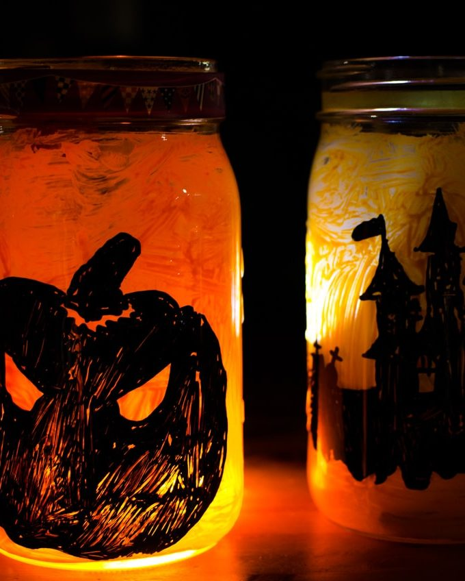 Give Halloween a glow with these DIY Halloween Mason Jar Lanterns. An easy tutorial to create fall fun decor at home.