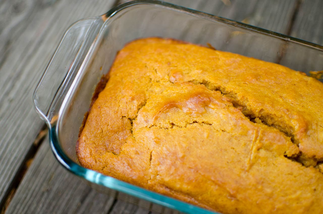 no egg pumpkin bread in glass baking pan on wood deck