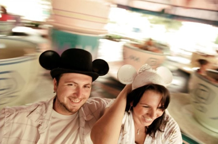 The spinning teacups at Magic Kingdom are the perfect photo spot during a honeymoon at Walt Disney World.