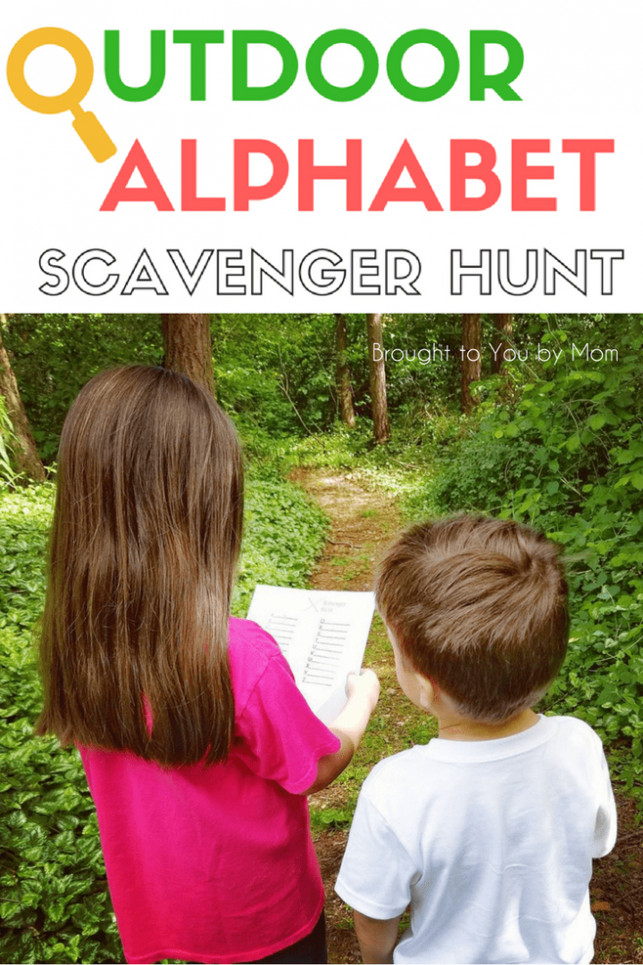 two kids doing an outdoor scavenger hunt