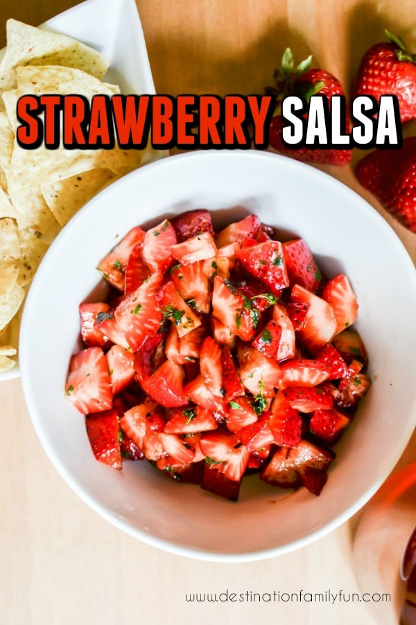 This Strawberry Salsa is the perfect summer snack to cool down with. A fresh berry recipe that is sure to please your taste buds. Check out just how easy it is to make this too. A few simple steps and you will be ready to enjoy a quick appetizer for a party or a fresh snack.#recipe #salsa #strawberry #snack #appetizer #summer #food #fresh #easy #quick #healthy #fruit