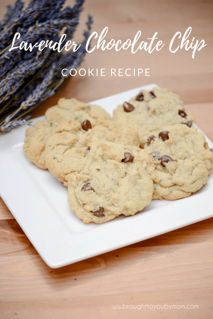chocolate chip cookies on white plate next to lavender