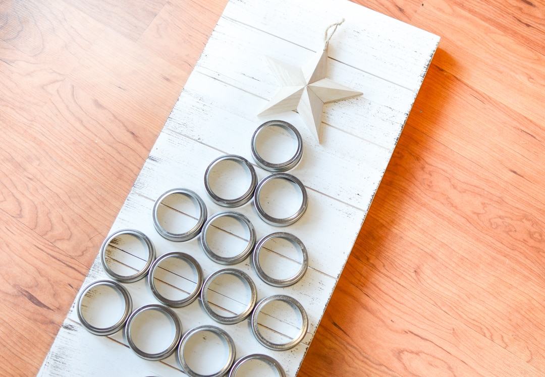 DIY Mason Jar Lid Christmas Tree that is simple to create and a beautiful piece of farmhouse style Christmas decor. Rustic Christmas crafts and home decor.