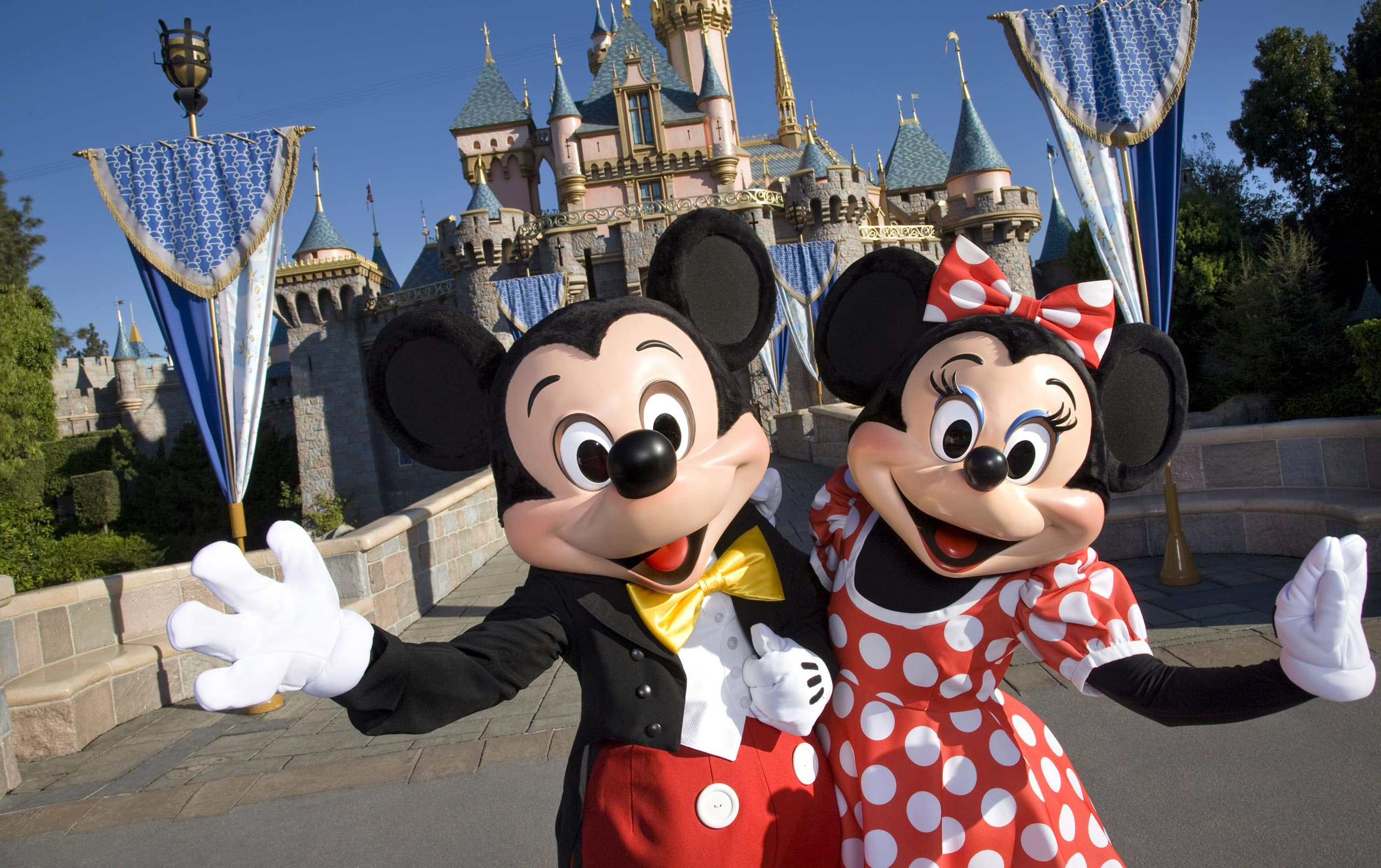 Minnie and Mickey in front of Sleeping Beauty Castle