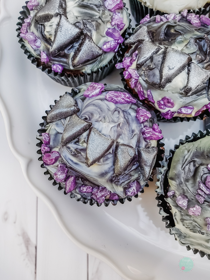 Black Panther cupcakes are a perfect way to celebrate the movie coming home to Marvel collections everywhere. These Black Panther cupcakes are much easier to make than they look. A must for a Black Panther themed birthday party.