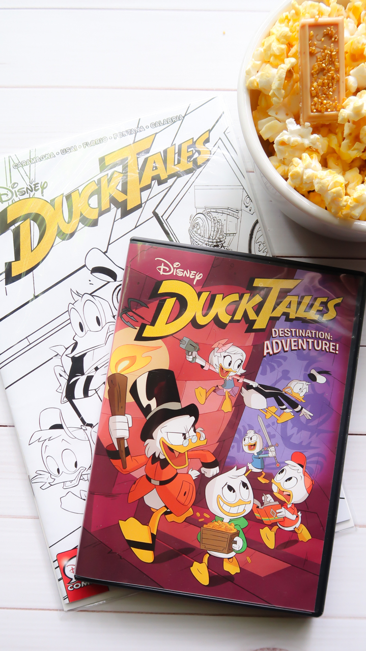 DuckTales Destination Adventure is coming home on DVD June 5th! Enjoy movie night with this DuckTales Snack idea: Uncle Scrooge's Pay Day Popcorn. Fun for family movie night, Disney party theme ideas, and more. (AD)#ducktales #destinationadventure #disney #movienight #movies #moviepopcorn #popcorn #recipes #snack #kids #ducktalesrecipe #ducktalescraft #ducktalesdvd