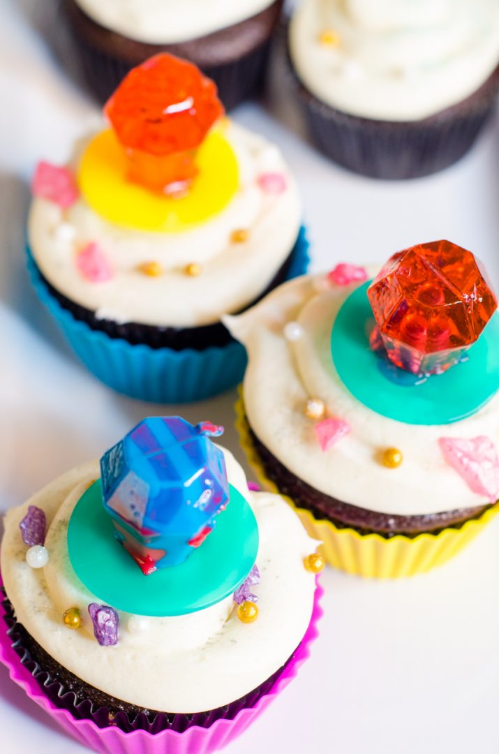 cupcakes with ring pops on the top