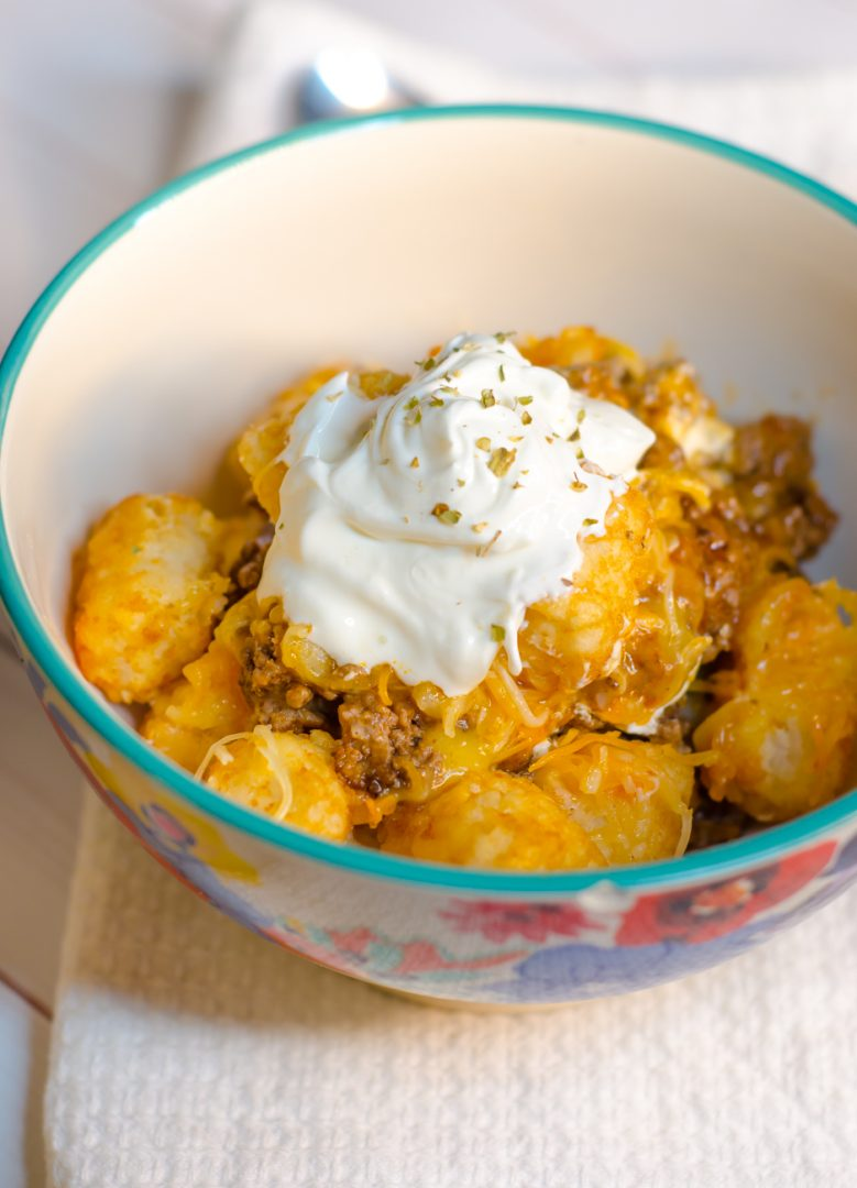 buffalo tater tot casserole in bowl with white hand towel underneath