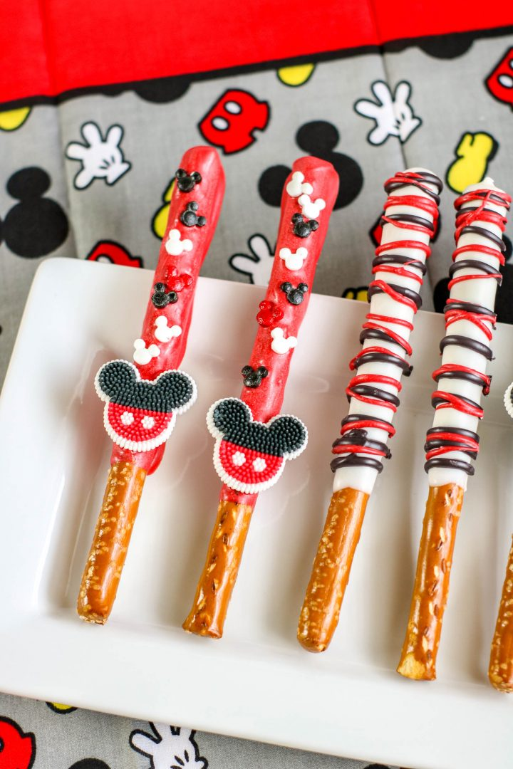 mickey mouse pretzel rods on white plate with mickey background