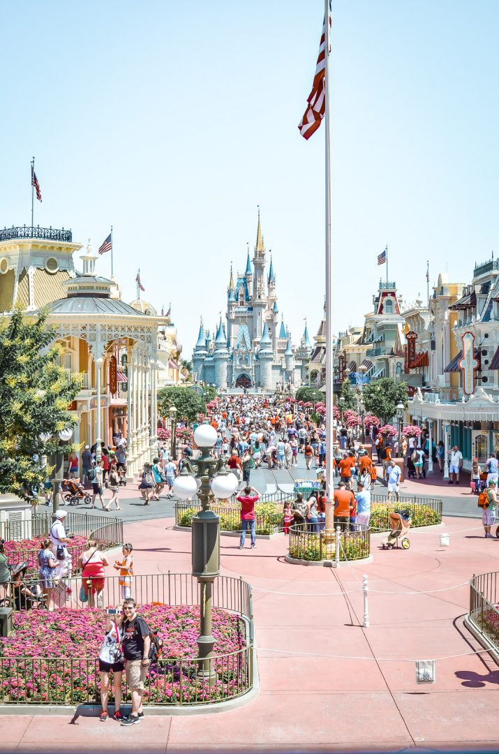 Main Street USA with flagpole in front of Cinderella Castle