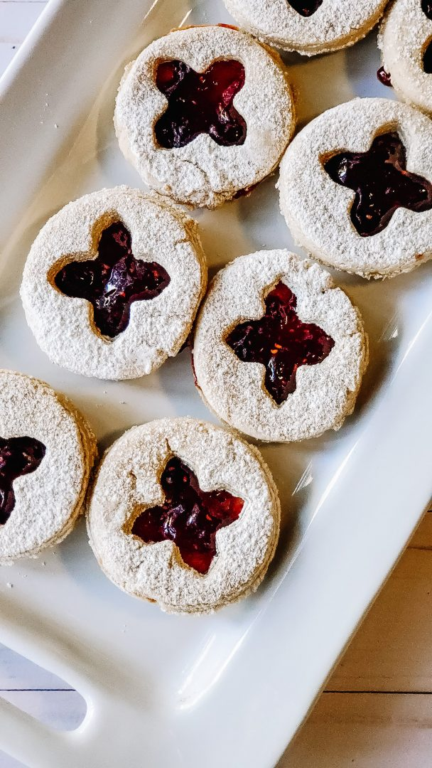 linzer cookies up close on white platter