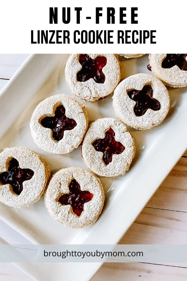 Nut-Free Linzer Cookies to be enjoyed by everyone this holiday season. Easy ingredients and simple to make. #linzercookies #nutfree