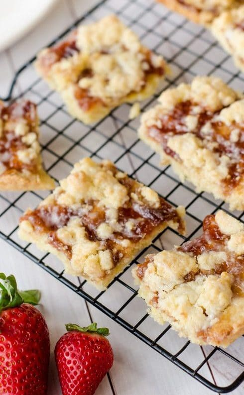 strawberry shortbread bars on cooling rack