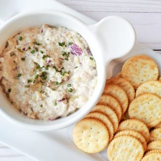 tuna dip in white bowl with crackers