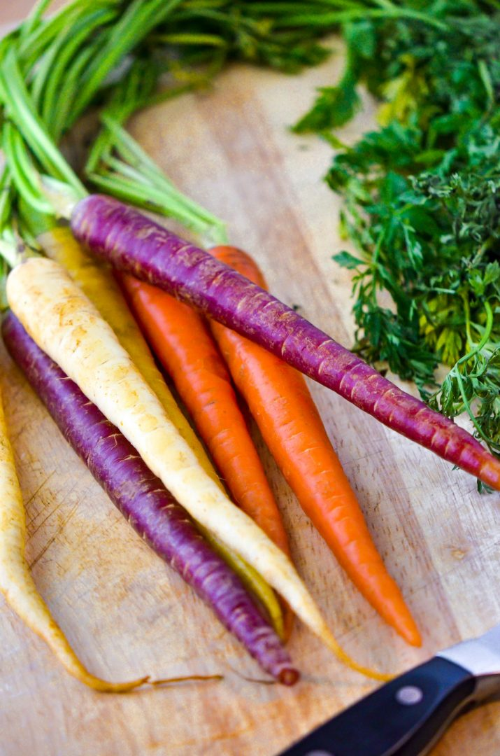 colorful carrots with knife and cutting board