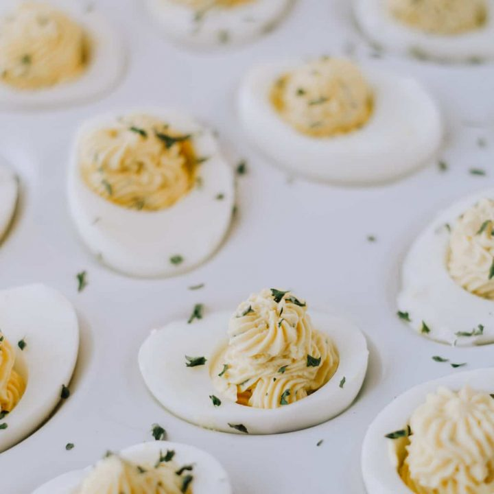 deviled eggs on white serving platter