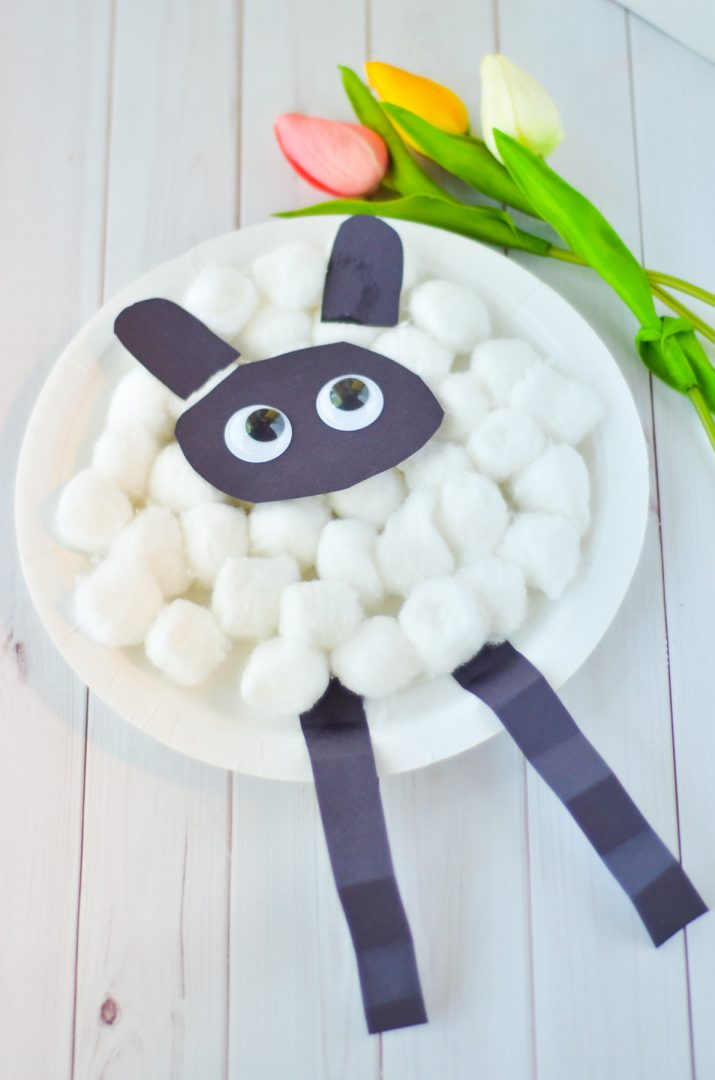 paper sheep craft on white wood