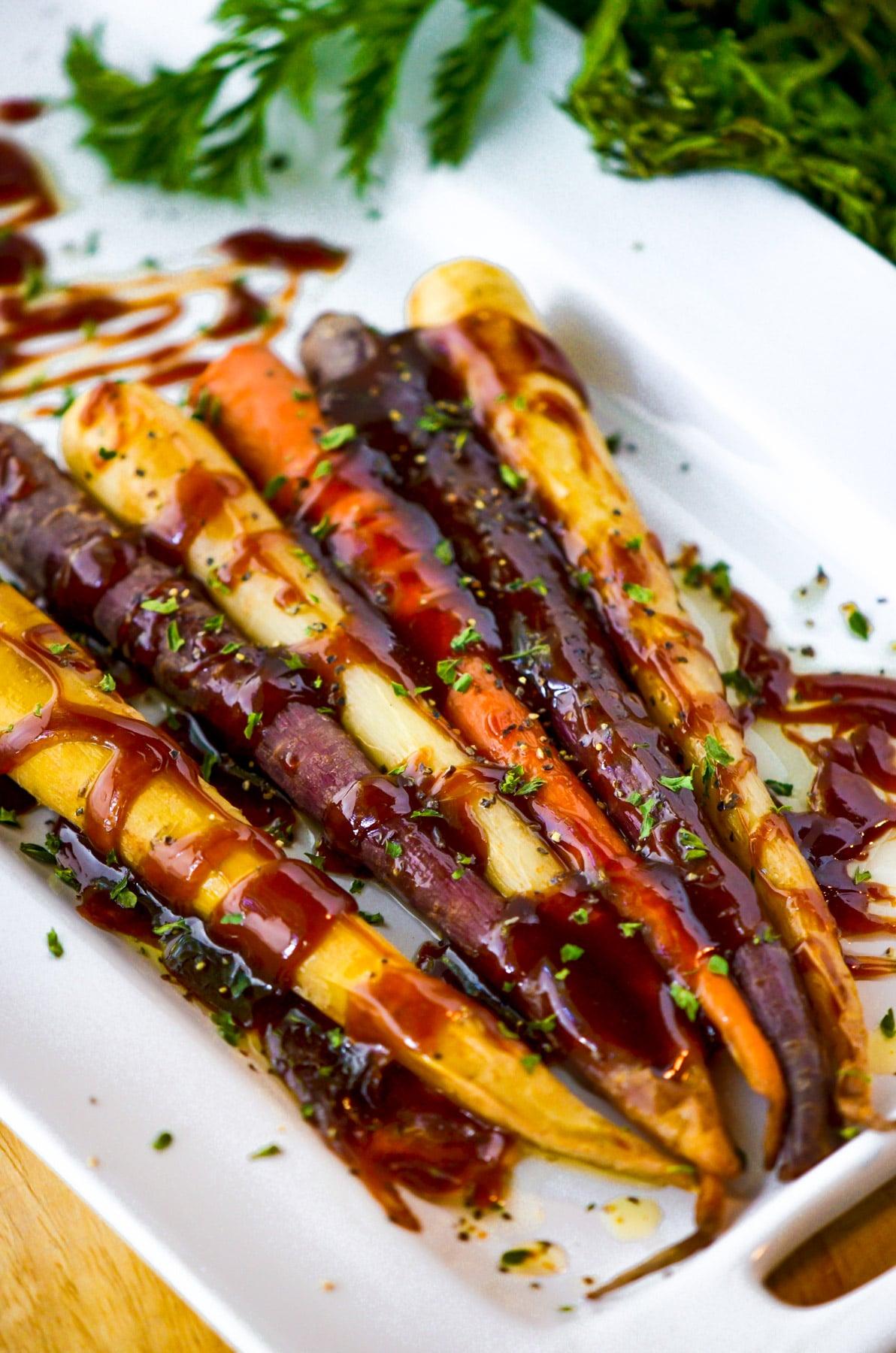 honey glazed carrots on white platter
