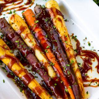 honey glazed roasted carrots on white plate