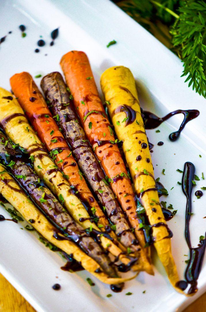 balsamic glazed rainbow carrots on white plate