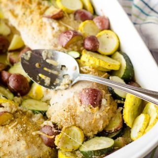 baked chicken with vegetables in white pan