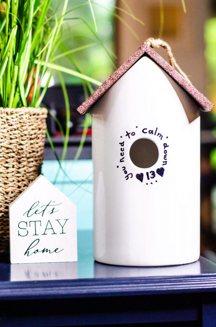 ceramic birdhouse on blue table