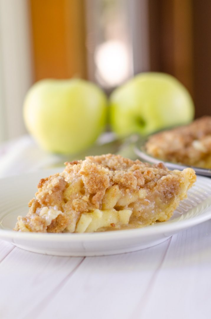 crumble pie on white plate with apples