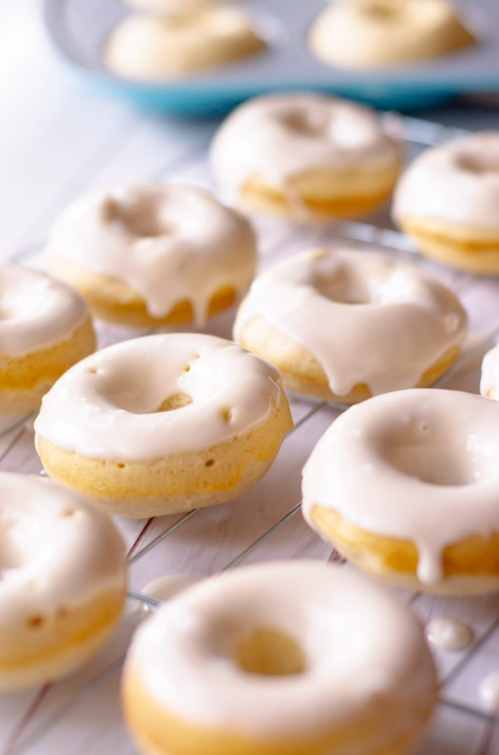 glazed baked donuts on a cooling rack
