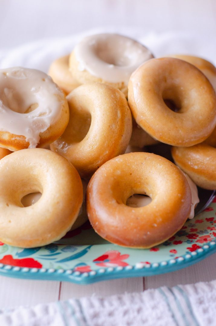 baked donuts piled together on a plate